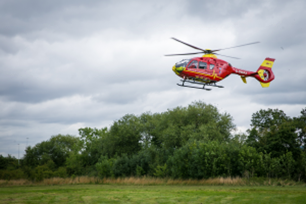 TRAPPED CAR DRIVER IS AIRLIFTED TO HOSPITAL